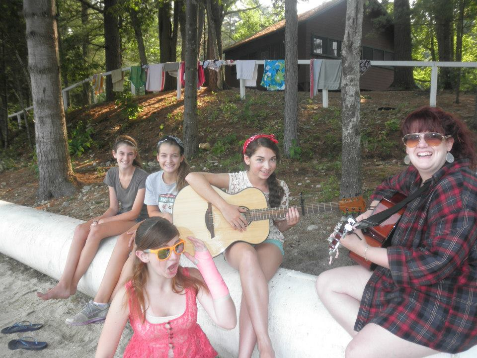 Learning to play the guitar. (Photo courtesy of Camp CenterStage)