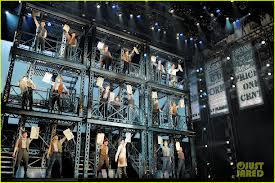 The NEWSIES set connects the newsboys to the workings of the city and us to them.