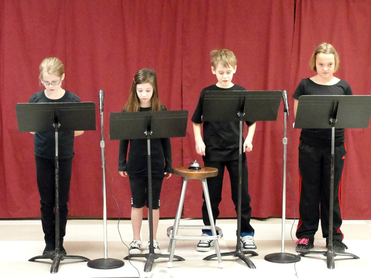 You can use music stands for the reading. This helps free students up a bit and makes reading easier.